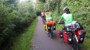 Aysel (centre) and teammate Meliha Kaya (right) ride through the Danish landscape with DGI.